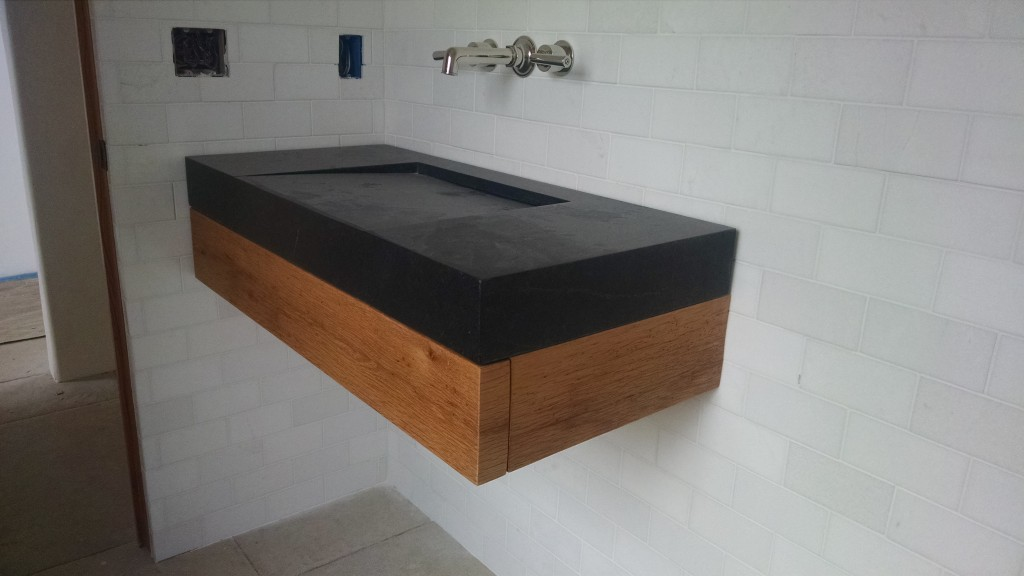 invisible drain soapstone sink installed